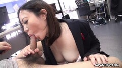 Asian brunette swallows a boner in the office Thumb