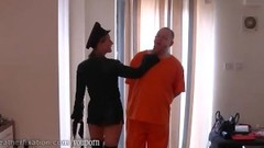 Dominant leather clad Mistress spanks prisoner slaves ass with her whip Thumb