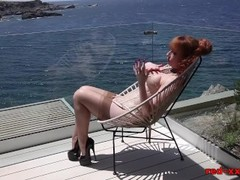 British redhead Red masturbating in front of the window Thumb
