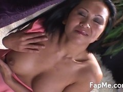 Horny Asian girl is on the couch grabbing and wanking a cock really hard Thumb