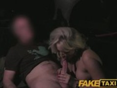 FakeTaxi MILF with huge juggs tits wanks the driver on backseat Thumb