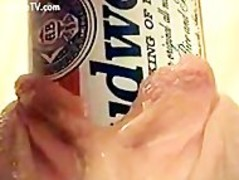 horny woman inserting a beer can deep into her wet pussy!! Thumb