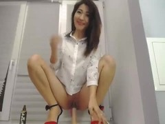 Cute Asian teen rides a dildo Thumb