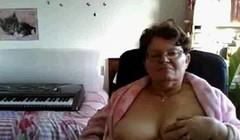 naughty granny flashing her big tits on cam Thumb
