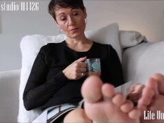 Dominant English lady foot soles ignore Thumb